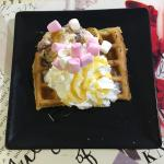 Waffle with oreo ice cream, marshmallows, whipped cream and golden syrup