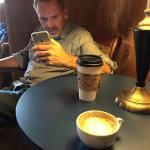 My friend Geoff Surrat checking his social network before my machiatto