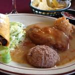 Beef taco, chile relleno with light brown gravy, rice and beans. DELICIOSO!