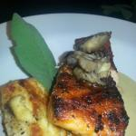Salmon topped with oyster mushrooms grilled smoked mozzarella polenta cake vellutata sauce
