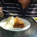 Delicious German Apple cake with cream and ice-cream