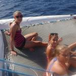 Kids loving the open waters and checking out the fish through the net
