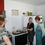 Chef Kelly describes her menu