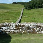 Hadrian's Wall, extending out from the fort