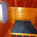 Double bed in master bedroom of 2 room kabin.
