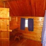 Seating area in master bedroom of 2 room kabin.