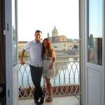 On our balcony, view of Arno River in background