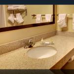 clean, spacious bathroom with mirror
