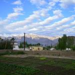 View of the farm in front of the house and the mountains beyond
