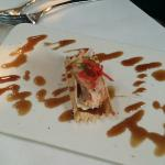 smoked salmon, bree cheese, honey glaze on a thin cracker (garnished with a sweet pepper like ta