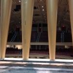 A view of the auditorium seating from behind the organ's facade