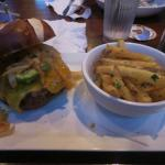 Black bean burger on pretzel roll with beer cheese and onions straws... along with garlic fries