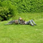 Local bicyclist having forty winks by the herbaceous border in Kongens Have