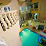 Part of the pool and the balconies that overlooks the ocean