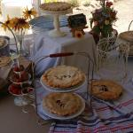 The ddessert table ahd wonderful pies and ice cream.