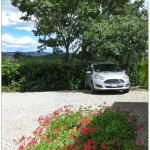 A shady spot for the hire car and a fabulous view from the hotel