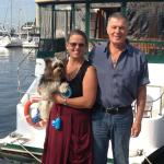 Our Hosts, Diane and Captain Ted with a visiting canine friend, Apollo.