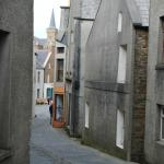 The main street of Stromness is shared by pedestrians and cars