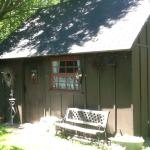 Exterior of the log house and the old stable