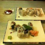 Sushi with salmon and sushi with avocado. Rolled inside out and created nice texture
