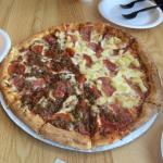 Large Pizza. Half meaty and half Hawaiian.