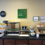 Complimentary breakfast bar: fruit, cereal, sweet/non-sweet breads