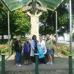 Visitors to the 9th Century Market Cross in Kells