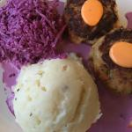 Crab cake entree with purple cabbage cole slow and real mashed potatoes