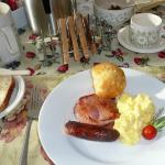 My bacon, sausage, scrambled eggs, a lemon muffin & a lovely decorated cherry tomato
