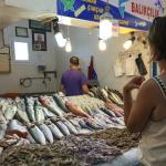 Choosing fresh seafood at the market next to Toros