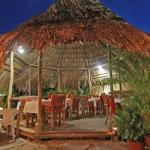 Dining at Kariwak Village in our open air restaurant
