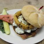 Blue Ox Burger, blue cheese, onion ring, balsamic reduction.