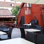 Outdoor seating.  A view towards the bar.