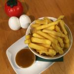 Bowl of Chips with Spicy Apricot Sauce.