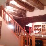 Staircase to upper level and kitchen