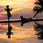 Our boys doing yoga at sunset at the infinity pool
