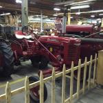 lots of antique tractors and farm equipment.