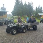 Bear photographers (and fishermen) are transported on little carts.