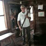 Davy Crockett fan with rifle and coon skin cap