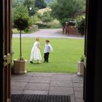 Flower girl and pageboy on the front lawn