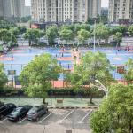 View from room of public basketball courts out front