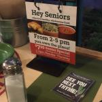 The table sign advertising their senior citizen special