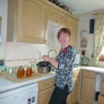 Helen at home in her kitchen.