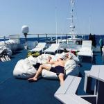 Relaxing on sun deck of the M/V fling between dives.