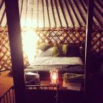 A yurt lit up for the evening