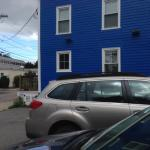 Parking for one car to each room. recently painted blue