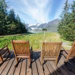Rocking chairs outside the lodge with the glacier in view