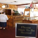 as you come in please wait to be seated