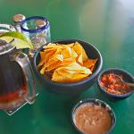 Chips, salsa and refried beans as an aperitif. Fresh made hot.