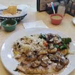 Delicious grilled tilapia in wine and mushroom sauce